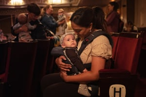 Stage-struck … a parents and babies matinee at the Vaudeville theatre, London.
