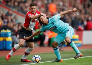 Southampton's Dusan Tadic gets to grips with Bournemouth's Nathan Ake as The Saints win 2-1 at St Mary's.