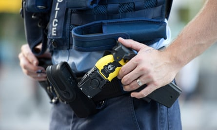 A police officer with a taser.