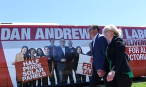 Victorian premier Daniel Andrews and his wife, Catherine, board an ALP-branded bus in Mordialloc, Melbourne on Wednesday.