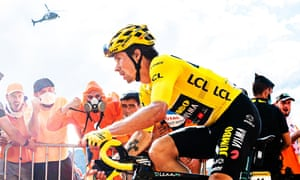 Primoz Roglic of Jumbo Visma in the yellow jersey is cheered on during the Puy Mary climb.