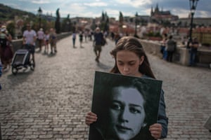 Prague, Czech Republic: a student holds a placard with a portrait of Milada Horáková as she commemorates the 70th anniversary of the lawyer's execution on Charles Bridge in Prague. Horáková, a politician who opposed the single-party Communist system, was the victim of judicial murder during the 1950s show trials. She was convicted on fabricated charges of conspiracy and treason and executed on 27 June 1950