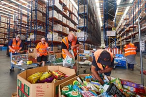 Volunteers organise large donations of goods at the Foodbank distribution centre in Sydney.