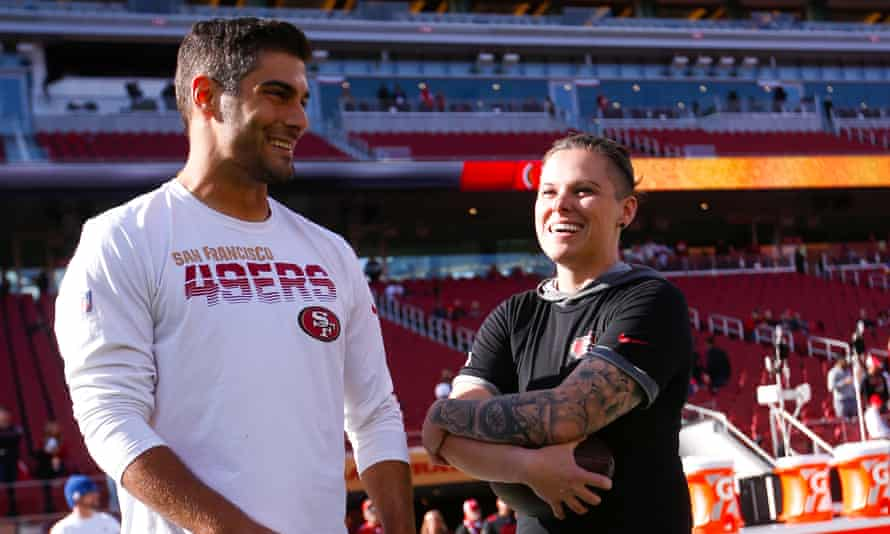 Jimmy Garoppolo chats with Katie Sowers before the 49ers' playoff victory over the Vikings this month