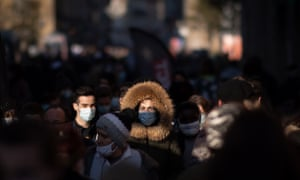 People walk down a street, on January 9, 2021 in Rennes, western France, amid the pandemic.