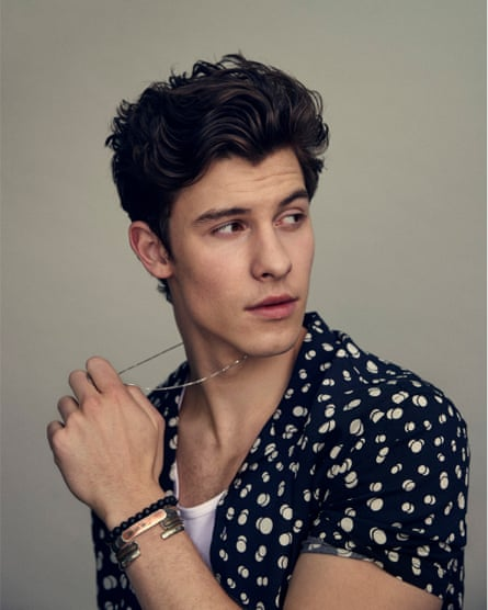 'I don't think of myself as conceited, but I spend a lot of time reading about myself': Shawn wears polka dot shirt by kooples.com and vest by sunspel.com.