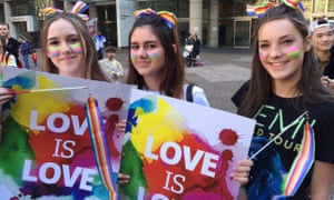 Marriage equality activists Megan Robinson,16, Demi Foundas, 15, Emma Langan, 15, march during a rally in Sydney in August 2015.