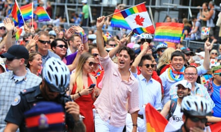 Justin Trudeau, the Canadian prime minister, waves a rainbow flag at the 2016 Toronto Pride event