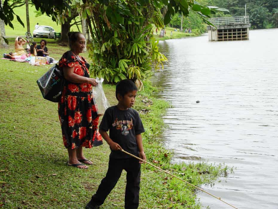 Young Iremamber Sykap fishing in Hawaii with his grandmother in 2012.
