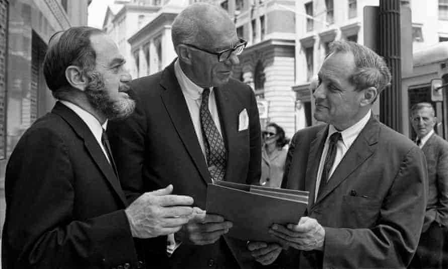 Benjamin Spock, centre, talks with his lawyers, during a break from his trial for conspiring to counsel young men to evade the draft.