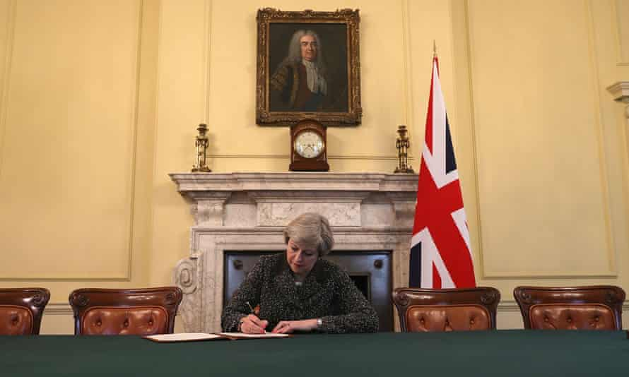 Theresa May signs the letter triggering article 50.
