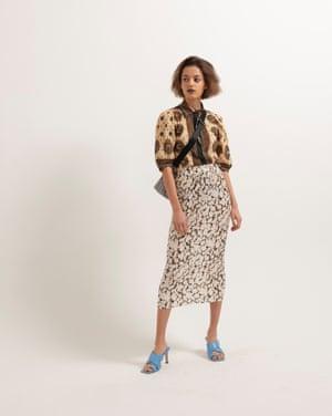 Kristianna wears paisley shirt, £209, uk.sandro-paris.com. Skirt, £22, asos.com. Heels, £59.99, zara.com. Camera bag, £69, arket.com