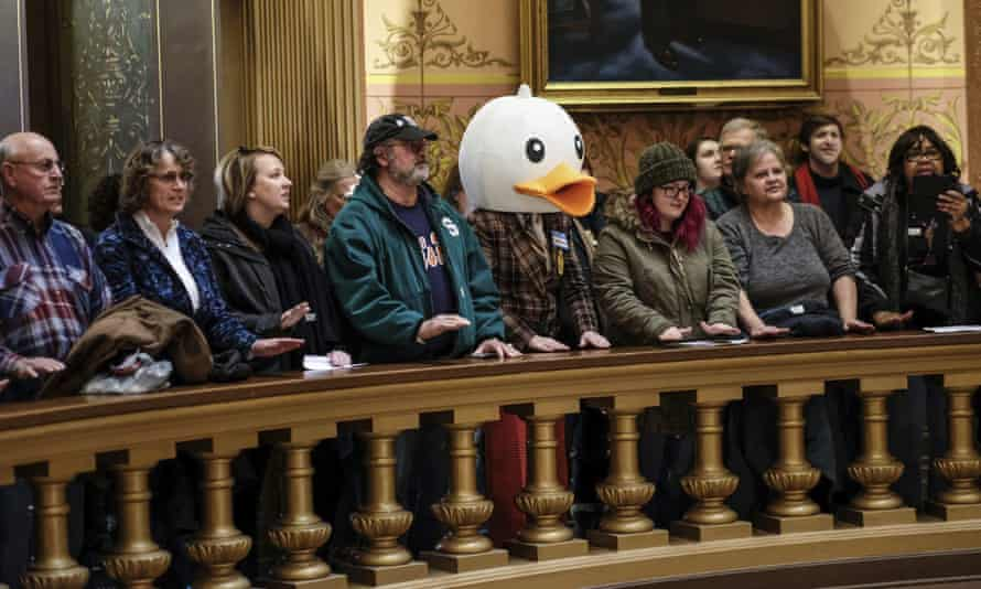 People protest in the capitol rotunda in Lansing, Michigan on 4 December.