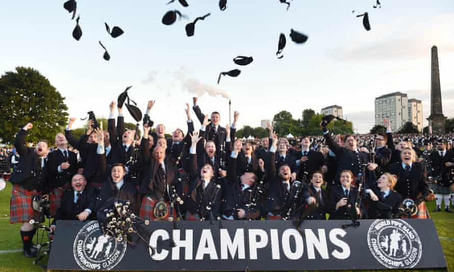 The Shotts and Dykehead Caledonia celebrate after winning the World Pipe Band Championships in Glasgow.
