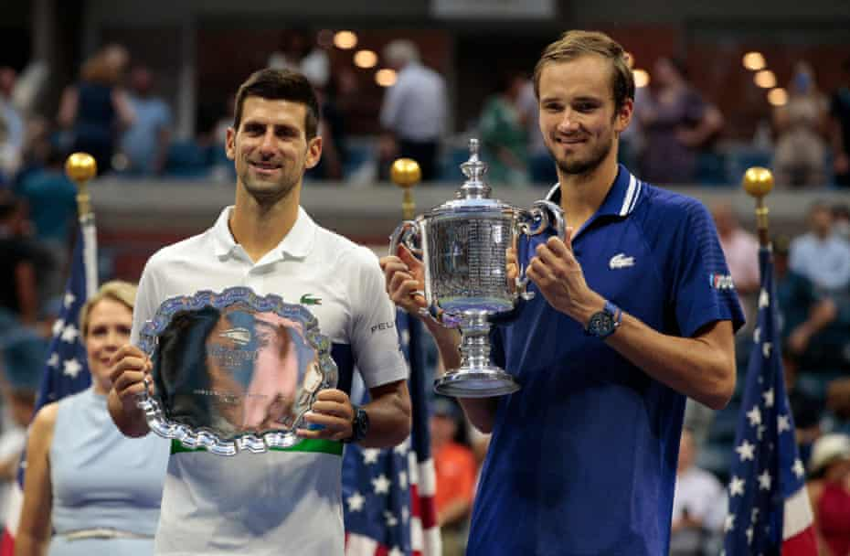 Daniil Medvedev and Novak Djokovic hold their trophies after the 2021 US Open final.