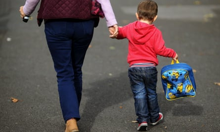 Mother taking son to childcare centre