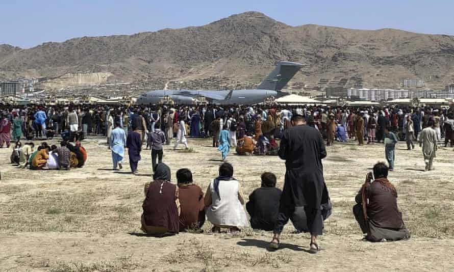People at Kabul airport seeking to flee the Taliban