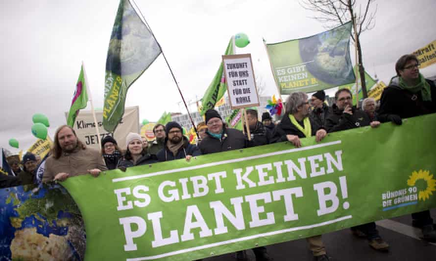 Environmentalist activists in Berlin on the eve of the climate change summit in Paris. Photograph: Stefan Boness/Ipon/SIPA