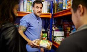 Thomas Radcliffe from the Merseyside Youth Association hands out food