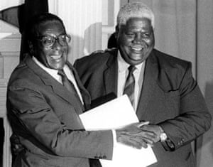 1987: The Zimbabwean vice-president, Joshua Nkomo, with President Robert Mugabe after signing the unity accord in December. On 30 December Mugabe became head of state after altering the constitution to usher in a presidential regime