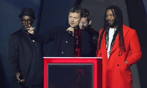 Damon Albarn, centre, and his group Gorillaz, collecting the best British band award.