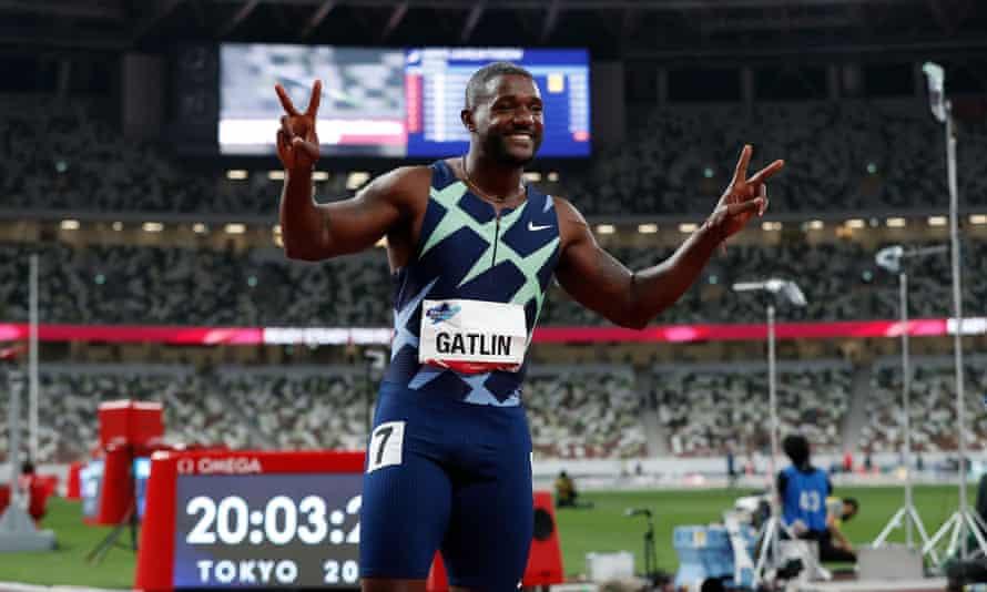 Justin Gatlin celebrates after winning the men's 100m final.