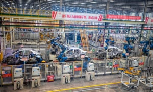 Robots assemble cars in an electric car factory in  China