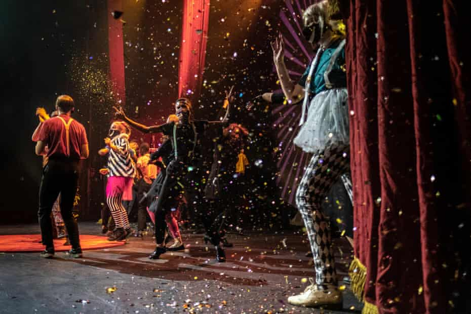 Confetti falls on performers from College of Magic at the end of a show at the Artscape theatre centre, Cape Town.