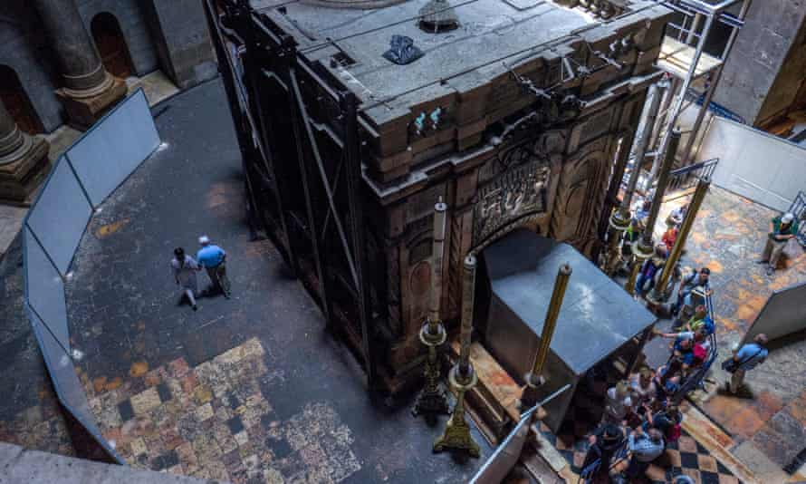 Pilgrims line up to visit Christ's tomb as renovation work on the site is in progress.