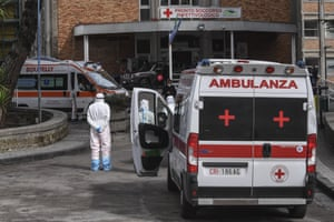 Ambulances and paramedics outside the Cotugno hospital emergency room for infectious diseases, Naples.