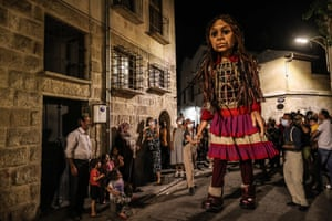 Gaziantep, TurkeyAmal, a giant puppet depicting a refugee girl, walks through the streets with Syrian refugee children. The 3.5-metre tall artwork will visit Turkey, Greece, Italy, France, Switzerland, Germany, Belgium and the UK to focus attention on the urgent needs of young refugees