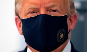 Donald Trump wears a face mask to help limit the risks of spreading Covid-19.