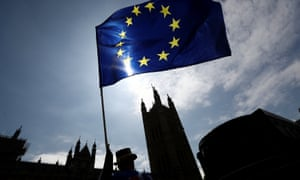An anti-Brexit protester waves an EU flag opposite the Houses of Parliament in London