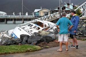 Locals inspect boats that hit rocks at Shute Harbour