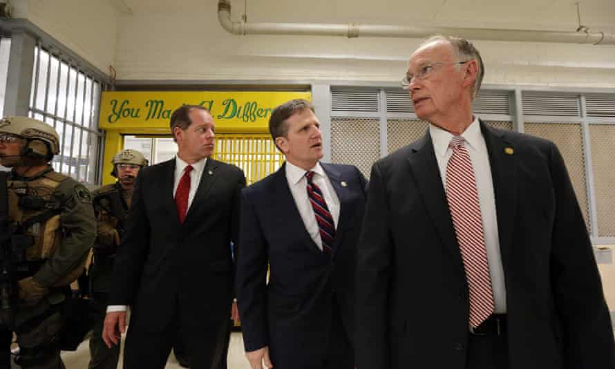 Alabama governor Robert Bentley (right) tours Holman prison in March 2016 following the two uprisings.