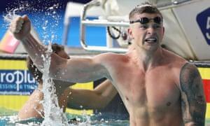 Adam Peaty celebrates his record-breaking swim