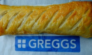 A Greggs sausage roll in its wrapper
