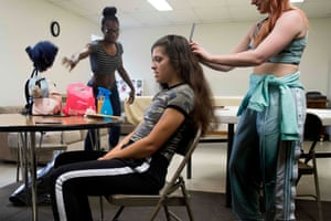 Scott throws her gear on a table as Palmer, her opponent for the Autumn Armageddon 2018, gets her hair done in their makeshift dressing room at a firehouse in Galena, Maryland.