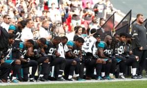 Jacksonville Jaguars vs Baltimore Ravens: players kneel during the U.S. national anthem.