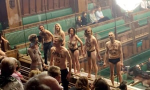 Semi-naked climate change protesters interrupt a Commons debate, spending 20 minutes with their buttocks facing MPs.