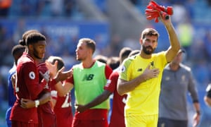 Liverpool's Alisson celebrates after the match.