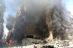 Smoke rises from a building after a Russian jet carried out airstrike over Meshed neighborhood of Aleppo