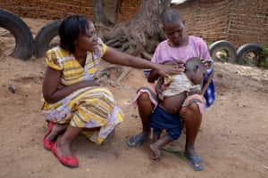 Phyllis Omido talking with a woman whose grandson is suffering from lead poisoning, in Owino Uhuru, Kenya.