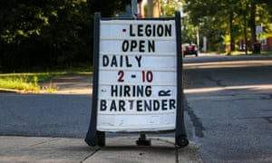 A sign outside of American Legion Post 71 announces a job opening for a bartender.