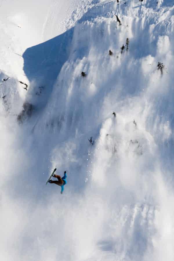 Snowboarder takes extreme crash in massive avalanche.