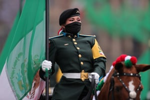 Soldiers wear masks during the Independence Day military parade at Zocalo Square in Mexico. This year El Zocalo remains closed for general public due to coronavirus restrictions.