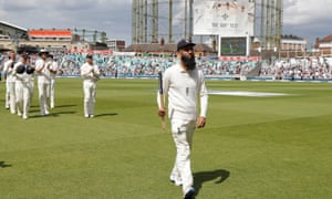 Moeen Ali leads his England team-mates from the field after his hat-trick finished England's big win over South Africa in the Oval's 100th Test.