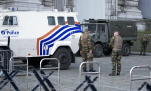 Police and Belgian army soldiers patrol outside the justice palace in Brussels on Monday.