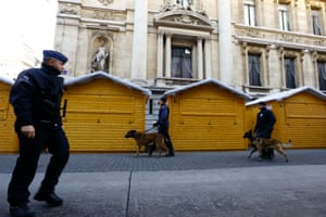 Policemen patrol outside the stock exchange center in downtown Brussels