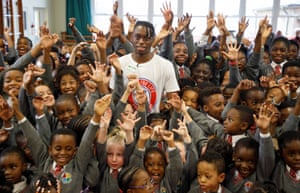 Aaron Wan-Bissaka in the assembly hall of Good Shepherd primary school near Croydon. 'It's mad to see,' he says of the adulation.